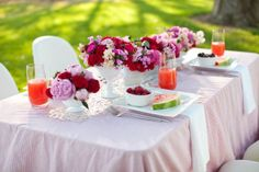 I love the pink and red flower centrepieces.