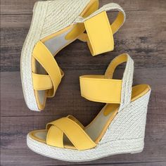Nine West yellow wedges Adorable yellow wedges. There are a few tiny blemishes on the fabric on the shoes as seen in photo #4 otherwise in great condition. 1 inch platform in the front. 5 inch heel. Super cute!! Shoe tag says 7 1/2 I personally think they are more like an 8 Nine West Shoes Wedges