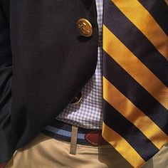 Navy blazer, light blue gingham shirt, navy & gold tie, khakis