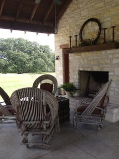 Got to love a central Texas patio with wicker furniture and a fireplace for relaxing!