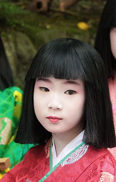 Participant in festival in the Bamboo Forest of Kyoto, Japan. She is dressed in junihitoe