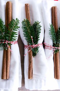 napkins adorned with cinnamon sticks and greenery