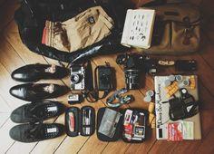 Cedric Viollet's vital kit :  1) Backpack Patagonia waterproof 2) Boardshort Deus ( toujours une plage ou une piscine dans le coin) 3) Un bouquin avec tout sur tout, plantes, vins, symbolisme des animaux, la forme des toits/pays etc… 4) Sac photo Bilingham, discrétion. 5) Boots classic Weston 6) Contax G2 + flash 7) Leica M (analog) 8)Pentax 67 9) Flask (Exclusivement avec du Cognac). 10) Ricoh GR1V (Toujours avec moi). 11) Shoes Saturday's 12) Buck Knife (Couteau de chasse, robuste). 13)…