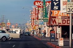 Las Vegas strip, 1965, copyright Denise Brown. Look at all of the mid-century signs, competing with each other for the viewer's attention.