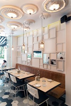 ecletic restaurant design mexico, white brick wall, wall art composition