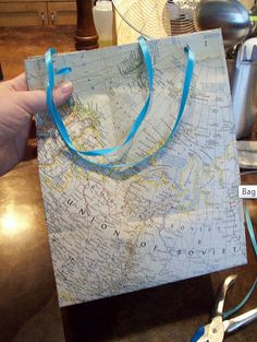 This is brilliant.  Took me a couple of test runs, but this works really well.  Love it for out-of-town gift bags. How to turn an old map into a gift bag | Offbeat Bride