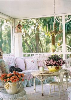 Looks like summer on this porch. shabby chic