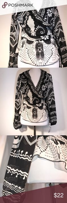 Rampage boho wrap sheer top shirt medium Sheer wrap shirt. Elastic cuffed sleeves. Ruffle trimmed Plunging neckline. Tie at waist. Be sure to like any items of interest to receive notifications of upcoming price drops. Rampage Tops Blouses