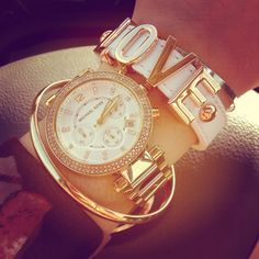 BCBGeneration Love bracelet, Michael Kors watch, gold & silver bangles #stackedwrist