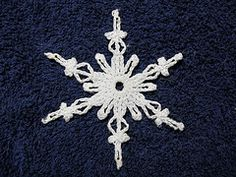 Summary 6-pointed snowflake with six short arms and six longer arms. Uses mostly chains and picots to form the arms. Part 3 of Variations on a Theme.