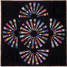 """Wheel of Scraps quilt, 55 x 55"""", pattern by J. Michelle Watts, made with a 9-degree wedge ruler"""