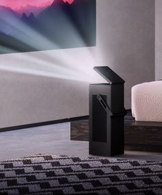 LG's first projector can beam a picture onto your wall - The Verge Lg 4k, Big Screen Tv, Shops, Home Theater Design, Cool Tech, Projectors, Smart Home, Swagg, Beams