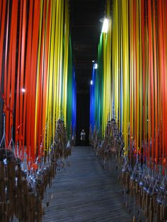 Currently showing at the 18th Biennale of Sydney is a gorgeous installation consisting of hundreds of bamboo wind chimes hanging from rows of colored ribbons. Called Knock On The Sky Listen To The Sound, it's by artist Tiffany Singh and it's on view in a cavernous hall of Pier 2/3 at nearby Walsh Bay.