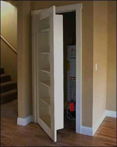 closet bookcase to hide the water heater, sump and furnace. Can be wall in bathroom in basement.