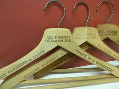 Set of 3 Vintage Wooden Cleaners  Advertisement Suit Hangers from Peacock Cleaners & Dyers in Delaware. $12.00, via Etsy.