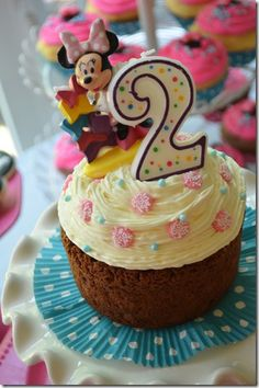 I like the idea of a big cupcake. get the mold, do it yourself but in pink minnie colours.