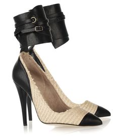 85484a3b5fe Black leather and ecru cotton-raffia pumps with a heel that measures  approximately 5 inches. Isabel Marant pumps have a pointed toe
