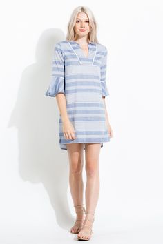 The bell sleeves on this dress adds a trendy element while the shift silhouette and stripes add a classic chic vibe.