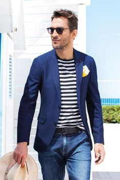 A navy suit jacket and blue jeans are a great outfit formula to have in your arsenal. Shop this look on Lookastic: https://lookastic.com/men/looks/blazer-crew-neck-t-shirt-jeans/20932 — Navy Blazer — Yellow Pocket Square — White and Black Horizontal Striped Crew-neck T-shirt — Black Leather Belt — Blue Jeans — Beige Straw Hat
