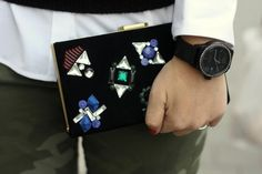 DVF bejewelled clutch and Marc Coblen watch