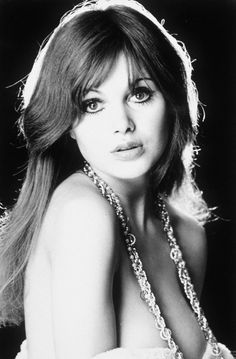 """Madeline Smith as Miss Caruso in the 1973 James Bond series film """"Live and Let Die,"""" the eighth spy film in the James Bond series to be produced by Eon Productions, and the first to star Roger Moore as the fictional MI6 agent James Bond Read Bond articles at: http://www.whattravelwriterssay.com/multicountrytravelindex.html"""