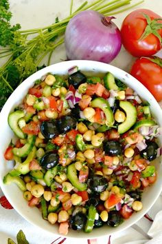 Chickpea Cucumber Salad is the perfect summer lunch or side dish. It's easy to make and is vegan, gluten-free, and healthy. #salad #chickpea #recipe #cucumber #tomatoes #vegan #glutenfree #healthy #healthyfood #mediterranean