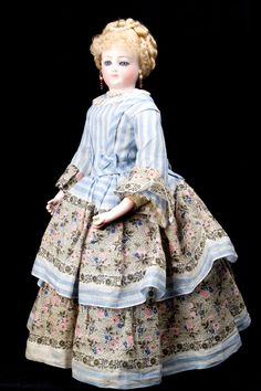 """This fabulous French Poupee simply takes your breath away! She is 14"""" tall, circa 1880's, made by Louis Doleac."""