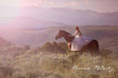 Fantasy and Fairytale like portrait of girl and horse. Soft and dreamlike in white dress
