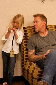 Daddy James! (I love the slight smile on James' face as he looks at his adorable daughter)