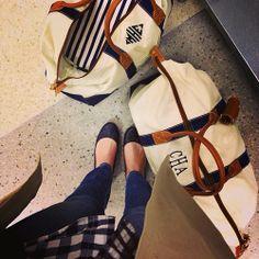 Matching J. McLaughlin monogrammed duffel bags.