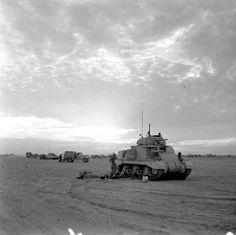 El Alamein 1942, British tanks wait to rejoin the battle at dusk.