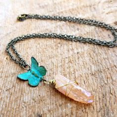 This necklace is the perfect trinket for any woodland fairy! It features an Amber colored quartz and butterfly with a lovely green patina, set on antiqued brass chain.  Measurements: Chain measures 18 Pendant measures 2 You will receive the exact necklace pictured.  Comes nicely packaged for gifting Please contact me with any questions you may have Thank you for shopping with bailybelle!  IG | @bailybelle Facebook | @bailybelle Twitter | @bailybelle