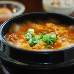 A quick and easy soondubu jjigae recipe made with kimchi. It& a stew made with uncurdled (extra soft) tofu and kimchi. Sundubu Jjigae Recipe, Soondubu Jjigae, Soup Recipes, Vegetarian Recipes, Cooking Recipes, Healthy Recipes, Healthy Food, Recipies, Recipes