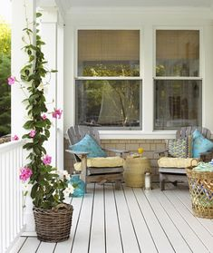 Porch..love the turquiose pillows and the turquiose glass accent piece on the deck