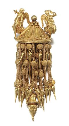 GOLD JEWEL, PROBABLY GIACINTO MELILLO, CIRCA 1860 In the Archaeological revival taste, designed as a tassel of foxtail linking accented with texture spherical beads terminating in pipkin drops, the surmount embellished with a pair of winged figures representing Nike, later converted to a brooch, French import marks to brooch pin, unsigned, later fitted case.
