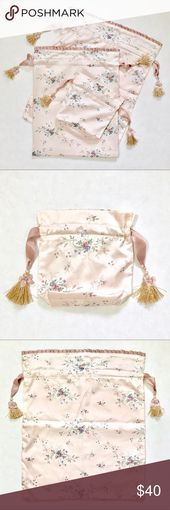 NEW floral stain travel bag set NEW floral satin bag set. Pink stain with floral...  NEW floral stain travel bag set NEW floral satin bag set. Pink stain with floral pattern. Drawstring opening with grosgrain ribbon. Beautiful and delicate tassels with faux pearl. Perfect for traveling, storage or gift to a lucky bride. Fully lined. Small and large are lined with satin. Medium one is lined with water resistant fabric.   Please check measu... #Bag #Floral #Pink #Satin #Set #stain #travel
