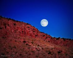 Harvest Moon rising above the Little Florida Mountains in Deming, New Mexico. Photo By Dan Gauss
