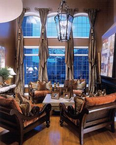 Stunning room decorated in monochromatic chocolate/soft beige tones.with a high light of cinnamon toned chair cushions. Tall Windows, Arched Windows, Tall Window Treatments, Window Coverings, Drapery Designs, Drapery Ideas, Curtain Ideas, My Living Room, Asian Living Rooms