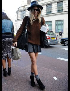 black leather a line mini, rust sweater, black hat, grey ankle socks, black booties