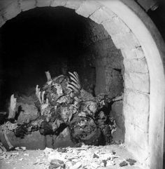 The remains of an incinerated prisoner inside a Buchenwald cremation oven, April 1945.