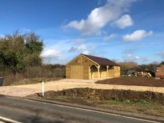 L Shape Stable Block with 3 Stables - Finer Stables Roof Joist, Ridge Cap, Shiplap Cladding, Hay Barn, External Lighting, Front Windows, Roofing Systems, Brickwork, Bespoke Design