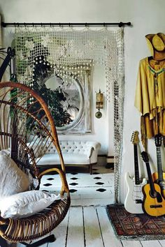 A crocheted curtain puts a chic twist onto the entryway of an understated room.   - HarpersBAZAAR.com