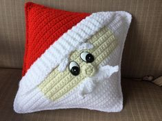 """This is a listing for a decorative Santa Pillow. It measures approximately 10"""" by 10"""".You will need the following to complete your project: Bernat Premium: White Red Heart Super Saver: Cherry Red and Aran 4 mm crochet hook 1 pair of 30 mm comical eyes (I purchased mine from 6060 on etsy, I've also been told they are available on Amazon) Polyester stuffing T-Pins used to hold your pieces together before sewing Stitch marker Tapestry needle"""