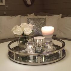 Perfect silver and sparkles with shiny mirror. Love this cute simple decoration for the coffee table Coffee Table Styling, Decorating Coffee Tables, Coffee Table Tray Decor, Candle Tray, Candleholders, Decoration Ikea, Table Decorations, Silver Decorations, Mirrored Coffee Tables