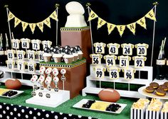 This is a great dessert buffet to support your favorite team with both the offensive and defensive players cookie jerseys. The football trophy is made of chocolate from a metal cake pan.