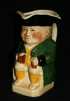 WOODS HAND PAINTED No.1 SIZE TOBY JUG WITH GREEN JACKET. 6.5""