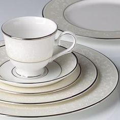 Opal Innocence by Lenox is my favorite of my two patterns. I love the white on white with the silver trim.