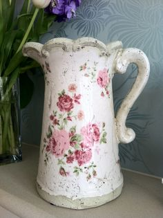 shabby chic pink rose jug is used to water my indoor plants at my cottage