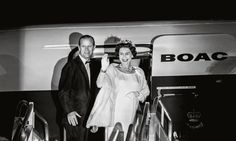The Royal Couple wave goodbye at the conclusion of their tour of the West Indies, 1966. Photograph: Harry Benson/Taschen book Her Majesty