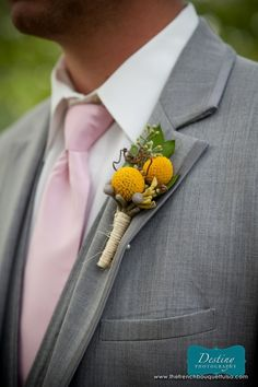 Groom Boutonniere  - billy buttons come in different colors. You can get them in a coral / peach color.